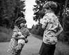 Closing the Distance. (icarium82) Tags: forest portrait bw nature child monochrome canoneos6d canonef50mmf14usm bnwblackandwhiteblackwhitewhiteandblackwnbschwarzweis face germany friends kind family road path sundaylights