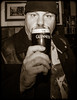 Guinness. (CWhatPhotos) Tags: cwhatphotos portrait beanie hat goatee beard pose sepia tint side view face pint guinness glass man male pub inn bar drink scarborough water blue north sea harbour yorkshire northyorkshire day walk stroll coast coastal olympus em5 ii lens pictures picture photographs photograph pic pics foto fotos image images with that have which contain south bay southbay
