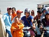 Kid Monk (mikecogh) Tags: phnompenh mekongriver ferry monk child faces cambodians motorbikes helmets