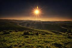 Starlight (Kevin_Jeffries) Tags: nikond800 nikkor sunstar newzealand hills kevinjeffries 240850mmf3545 f22 hazy sunlight light flare canterbury southisland radiance soulful solar sundaylights greenscene geotagged