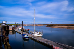 The Harbour (rustyruth1959) Tags: nikon nikond5600 tamron16300mm uk england eastanglia norfolk wellsnextthesea harbour port seaside water sea tide sand moorings boat yacht railings walkway path pontoon buildings blue masts reflections beacon lowtide sky clouds resort poles alamy