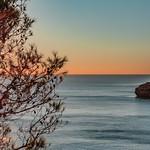 Sun star near cliffs thumbnail