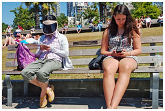 The Visor from Outer Space (HereInVancouver) Tags: youngwomen phones visor candid streetphotography vancouverswestend lifeonaparkbench englishbaypark seawall vancouver bc canada canong16