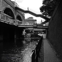 Connectivity (innpictime ζ♠♠ρﭐḉ†ﭐᶬ₹ Ȝ͏۞°ʖ) Tags: manchester bridge pedestrians architecture water wall brickwork canal lock railings walkers waterway towpath footpath blackwhite steps arches rochdalecanal stairway canallock 534744752249473 levels structures communication routes monochrome