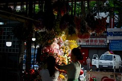 Flower Vendors:  Early Morning Set-Up (Ginger H Robinson) Tags: flower vendor early morning preparation setup benthanh market saigon district1 vietnam vibrant color