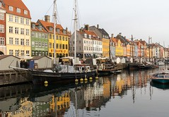 Copenhagen (Karen_Chappell) Tags: copenhagen denmark travel europe boats boat reflection reflections canal buildings architecture yellow red green blue orange multicoloured colourful colours jellybeanrow nyhavn water waterfront
