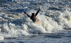 Swimming (mootzie) Tags: sea beach aberdeen waves froth white lady swimmer buoy yellow wetsuit jumping scotland cold november