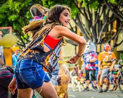 Throwing Tortillas (Kevin MG) Tags: pasadena pasadenadoodah doodahparade parade girl girls young youth cute pretty little adolescent preteen tortillas funny hdr braces smile