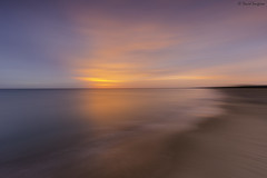 Dreamlike Sunrise. (dasanes77) Tags: canoneos6d canonef1635mmf4lisusm tripod landscape seascape cloudscape beach sunrise clouds longexposure dawn dreamlike colors blue orange sand shoreline valencia albuferaofvalencia
