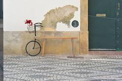 design of a bench (Hayashina) Tags: algarve olhao portugal bench wheel flower door pattern hbm