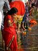 varanasi 2017 (gerben more) Tags: prayer red water woman varanasi benares ritual sari india