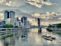Brisbane sunrise (Lance CASTLE) Tags: skyline boat sky cityscape landscape outdoor water brisbanecity sunrays citycat brisbaneriver bridges clouds horizon iphone hdr skyscraper city river building snapbrisbane