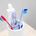 Toothbrush in a White Bowl with Toothpaste