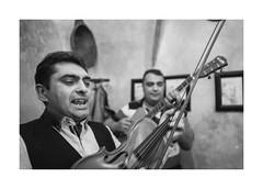 Violinist (Jan Dobrovsky) Tags: band leicaq blackandwhite pub krumlov document monochrome reallife roma grain evening social gypsies indoor