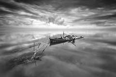 Delta Dreams B&W V. (dasanes77) Tags: canoneos6d canonef1635mmf4lisusm tripod landscape seascape cloudscape dramaticsky blackandwhite ocean sea boat longexposure deltadreams tarragona