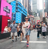 Times Square - July 4 (UrbanphotoZ) Tags: woman americanflag texashat cowboyhat camera tourists pedestrians july4 fourthofjuly shawl shorts shades timessquare henribendel smartphones stubhub morganstanley hersheys reeses wicked tkts hello plaza broadway manhattan midtown westside newyorkcity newyork nyc ny