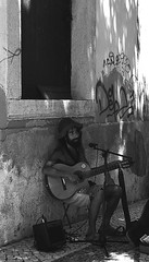 Sidestreet Busker Lagos (joelpwilliams) Tags: street streetphotography busker portrait onthesteets guitar blackandwhite bw blackandwhitephotography black white travel travelphotography trip town europe exterior people sigma nikon traveling structure still grey day daytime portugal lagos followback follow4follow flickr graffiti holiday life lines zoom zoomlens composition culture closeup crop overcast