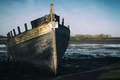 Emerging from the Shadows (ShrubMonkey (Julian Heritage)) Tags: wreck nautical decay derelict abandoned clinker hull shipwreck chichesterharbour dellquay bow boat neglected forsaken shadows emerging