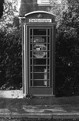 Telephone Defibrillator (Man with Red Eyes) Tags: defibrillator telephonebox berggerpancro400 pyrocathd 11100 16mins 70f leicam2 zeissplanar50mm homedeveloped analog analogue blackwhite monochrome silverhalide sunnysixteen filmtest