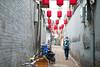 A man walking in a street with red lanterns in Pingyao (leonardrodriguez) Tags: redlanterns lanterns lanternes lanterne street walking people travel man manwalking chinese 中华人民共和国 cinese chineseman chinois 平遙 china shanxi cina chine pingyao ancientcityofpingyao
