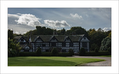 Speke Hall, Front, Speke, Liverpool (prendergasttony) Tags: hall history speke liverpool lancashire merseyside nikon d7200 tudor nationaltrust nt cloud sky trees uk elements bw blackwhite garden clouds green building architecture grass tree road england old