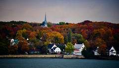 Sainte-Pétronille Church on the Saint Lawrence River - Île d'Orléans Québec Canada (mbell1975) Tags: saintepétronille québec canada ca church saint lawrence river île dorléans ville de canadien canadian qc st ste water gateway fall autumn color leaves colour tree trees foliage steeple isle island orleans
