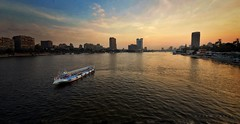Intercity  ... Glorious Nile (Hazem Hafez) Tags: boat nile water cairo city horizon skyline sunset sky buildings river clouds