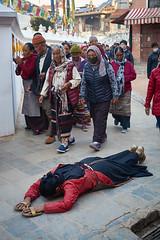Tibetan pilgrim making full body prosternation while makin the Kora around Boudhanath Stupa, Kathmandu, Nepal 2 (Alex_Saurel) Tags: tibétains monastère pangden drapeauxàprière gompa pelerins tabliertibétain asie prostrating culture fullbodyprostration 35mmprint malanecklace pilgrimage tibetanapron scans tibetanprosternation tibetandress laying སྐོར་ར prostration kora asian masque mask pattern motif circumambulation action bouddhisme tibetanpeople group buddhism people khāsacaitya boudhanath asia prayerflags streetscene khāsti travel sanctuairebouddhiste lifescene बौद्धनाथ pilgrims imagetype buddhistsanctuary photospecs photoreport jarungkhashor photoreportage reportage kathmandu bouddhanath bodnath byarungkhashor photojournalism stockcategories religion day traditional time katmandou tradition nepal scènedevie lifestyles sony50mmf14sal50f14
