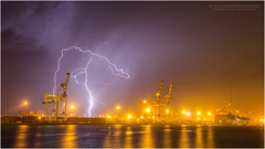 Fremantle Harbour lightning (beninfreo) Tags: lightning fremantle westernaustralia fremantleharbour storm thunderstorm thunder crane cargo reflection australia canon