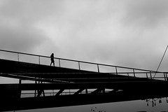 By coming down from the sky (pascalcolin1) Tags: paris13 woman femme ciel sky passerelle footbridge nuages clouds photoderue streetview urbanarte noiretblanc blackandwhite photopascalcolin 5omm canon canon50mm