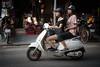 self-determined (grapfapan) Tags: scooter helmet girls women hanoi vietnam motorbikes people street travel