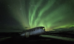 KRYPTONITE (Stephen Hunt61) Tags: nature plane wreck landscape landscapes landmark iceland sky snow winter aurora auroraborealis auroraboreale rottame nightphotography natural lightpainting stefanocaccia outdoor sand