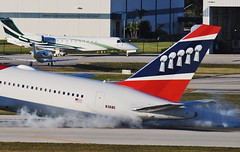 Touchdown Patriots! (Infinity & Beyond Photography) Tags: new england patriots boeing 767 767300 b767 nfl team plane private jet aircraft fortlauderdale ftlauderdale airport fll kfll smoke smoky landing