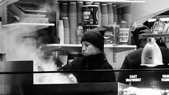 festive market at night 04 (byronv2) Tags: edinburgh edinburghbynight night nuit nacht festivemarket christmasmarket market princesstreetgardens princesstreet mound newtown blackandwhite blackwhite bw monochrome peoplewatching candid street winter stall shop shopping food drink drinking steam chef cooking diner