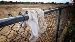 STRADDLING THE FENCE (akahawkeyefan) Tags: shorts pants fence chainlink davemeyer fresno dirt earth