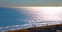 nave (archgionni) Tags: sea water sky blu blue riflessi reflections sole sun luce light onde waves nave boat spiaggia beach sabbia sand orizzonte horizon marche italia italy lumen