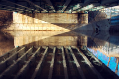 A Grand Moment Under the Bridge (matthewkaz) Tags: bridge overpass underpass river grandriver water reflection reflections angles triangle triangles light washington washingtonave downtownlansing lansing inghamcounty michigan 2017