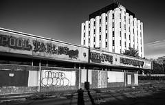 abandoned (dpowersdoc) Tags: bleak deserted empty abandoned pooltables billiards games hottub graffiti storefront pool grandfather realestate shadow selfportrait officebuildig