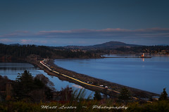 Coburg Commute (matalest) Tags: victoria colwood lighthouse headlight sunset lagoon ocean beach coburgpeninsula esquimaltlagoon lighttrails vancouverisland canada westcoast