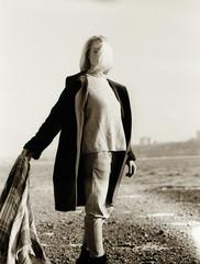 fall (Ivan Ovchinnikov) Tags: portrait film kodak 5222 girl wind blond hair canoscan canon mark 9000f nikon nikonf4 50mm 35mmfilm light sunlight пермь ивановчинников ivanovchinnikov chiile select russia beach