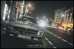 Mercedes Benz SL R 107 (Krueger_Martin) Tags: strase street invalidenstrase city stadt urban light lights licht traffic verkehr mercedes mercedesbenzsl r107 car auto reflex reflections spiegelung nacht night hdr photomatix weitwinkel wideangle olympus olympuszuiko24mmf28 zuiko 24mm festbrennweite primelense berlin dark dunkel colorful bunt farbig