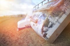 Days End... (KissThePixel) Tags: sunday sunnyday sunset sunsets light pinksky sky beach sand landscape beachscape beacheslandscapes boat dinghy fishingboat bokeh november nikon nikondf 50mm nikkor nikkor12 f12 12 depthoffield dof dofalicious bokelicious soft pastel autumn