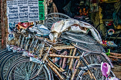 bikes.jpg (Pejasar) Tags: bicycles stacked store market street color texture artistic india