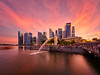 Blazing Bay (Scintt) Tags: singapore marina bay merlion park raffles place city hall cityscape panorama stitched landscape tourism travel light cloud sky railings lines sands hotel integrated resorts offices skyscrapers financial sector centre cbd mbs long exposure slow shutter multiple water reservoir lake pond museum art science modern urban epic surreal icon fountain spray flow scintillation scintt jon chiang photography skyline glow sunset sun clouds evening dusk orange yellow golden dramatic monument statue vertorama popular