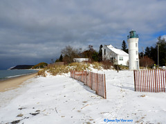 Winter Beach (JamesEyeViewPhotography) Tags: winter lake michigan greatlakes lighthouse water waves beach sand sky clouds snow fence landscape lakemichigan northernmichigan nature november trees jameseyeviewphotography robert h manning memorial