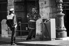 Police vs Centurion (Roberto Spagnoli) Tags: uniform divisa police centurion blackandwhite biancoenero fotografiadistrada streetphotography monocromo people policewoman roman