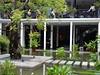 Pond in Hotel Courtyard (mikecogh) Tags: phnompenh plantationurbanresortandspa hotel pond courtyard entrance steppingstones diners