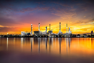 Petrochemical plant area with reflection in river