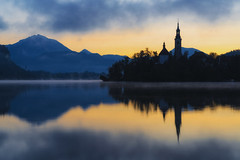 Sunrise In Bled (JH Images.co.uk) Tags: bled morning church mountains lake slovenia hdr dri clouds reflection trees sunrise