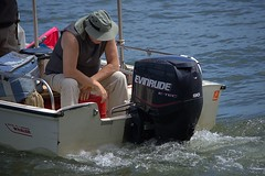 Motor Watching (swong95765) Tags: boat outboard motor man guy male water river seated watch boating humor evinrude bostonwhaler staring